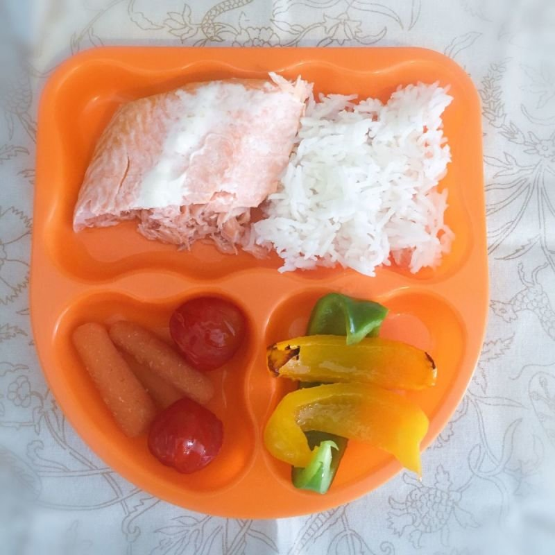 Fresh baked salmon with rice and vegetables