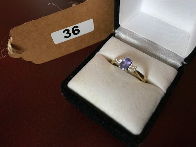 Lot 36 - 18ct Gold Ring with Diamonds & Purple Stone - £120 to £150