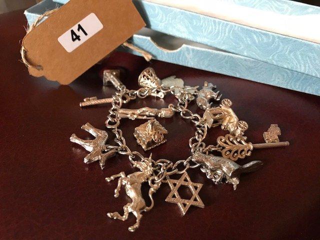 Lot 41 - Silver Charm Bracelet - £60 to £80