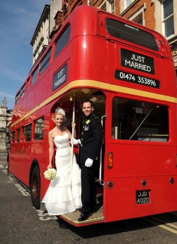 Married Couple with Wedding Bus