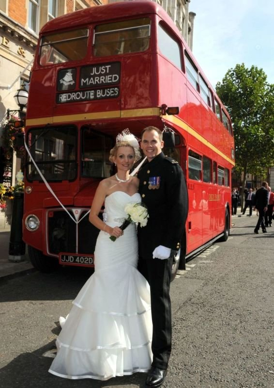 Happy Couple in Front of a Routemaster
