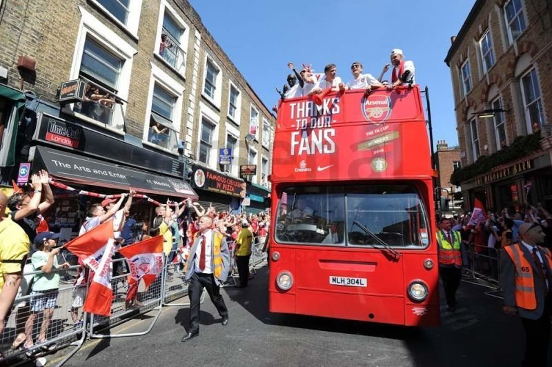 Arsenal Players celebrating with fans on Open Top Bus