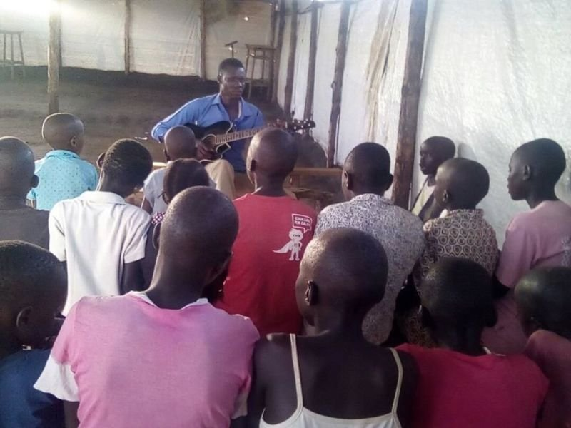 Our Secretary Seme Ludanga Training the Children