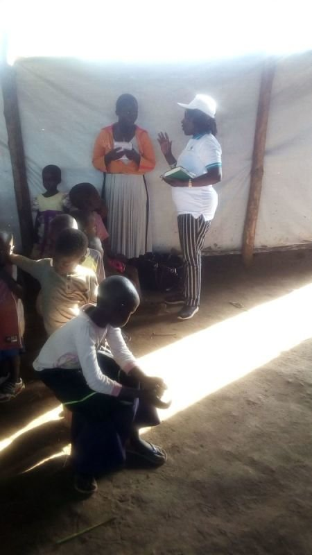 Apostle Grace Ministering to I CAN children