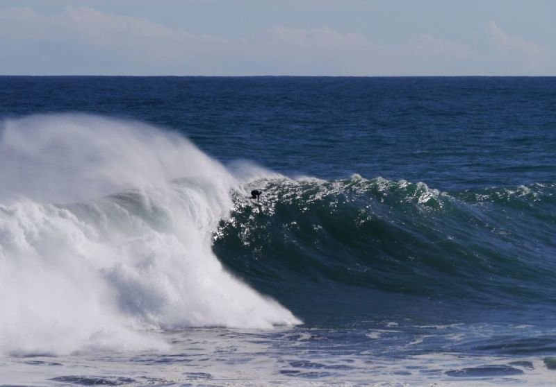 Big wave drop in Punta de Lobos, Pichilemu