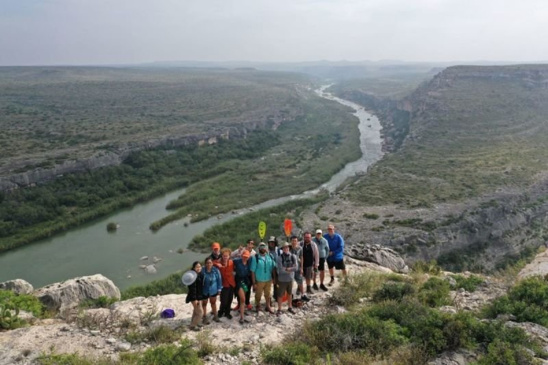 Group Photo with Cretaceous Carbonates at the Pecos River