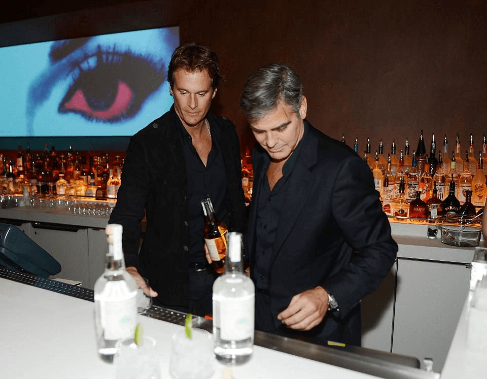 Casamigos Tequila founders Rande Gerber and George Clooney celebrate the launch of Casamigos at Andrea's at Encore Las Vegas on January 9, 2013 in Las Vegas, Nevada. (Photo by Denise Truscello/WireImage)