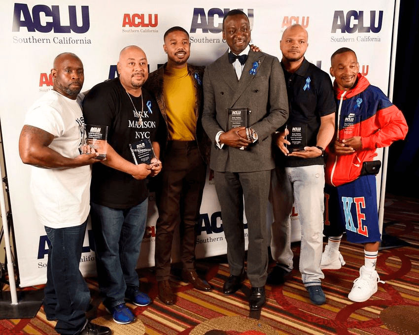 Presenter Michael B. Jordan, third from left, poses with, from left, honorees Antron McCray, Raymond Santana, Yusef Salaam, Kevin Richardson and Korey Wise at the ACLU SoCal's 25th Annual Luncheon at the JW Marriott at LA Live, Friday, June 7, 2019, in Los Angeles. (Photo by Chris Pizzello/