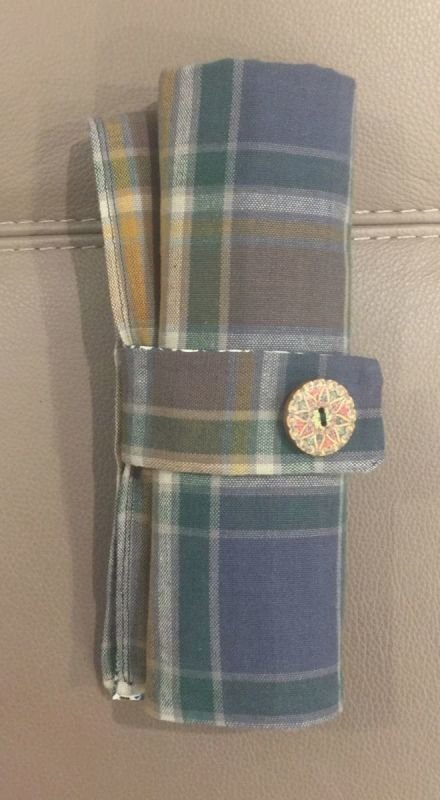 Manx Hunting Tartan on top, waterproof underneath.