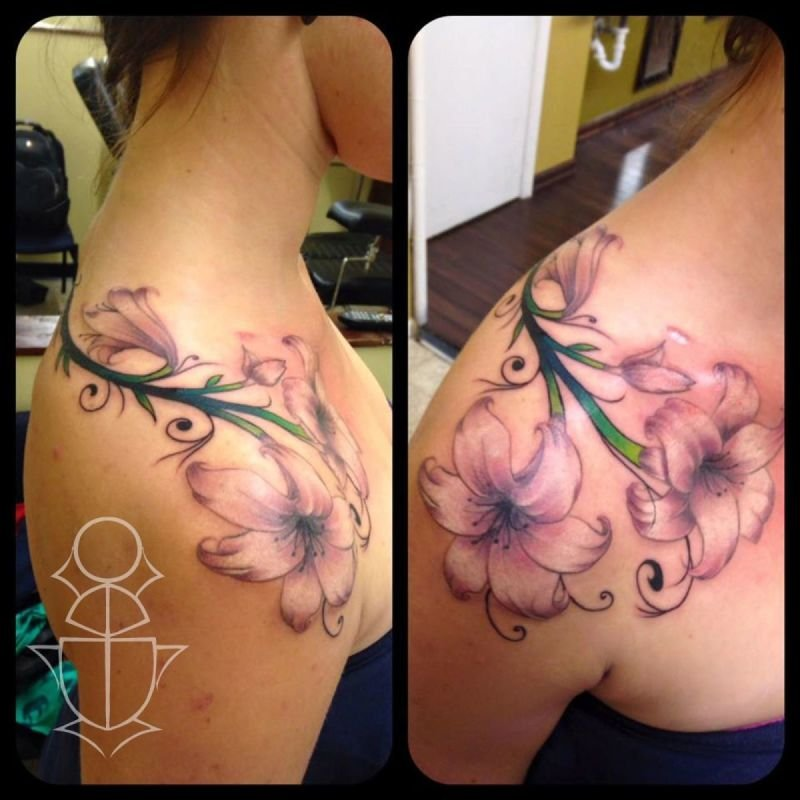 Lilies over the shoulder tattoo