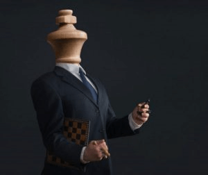 Businessman with head of a wooden chess king carrying chessboard and pieces. This is what co-parenting with a narcissist is like