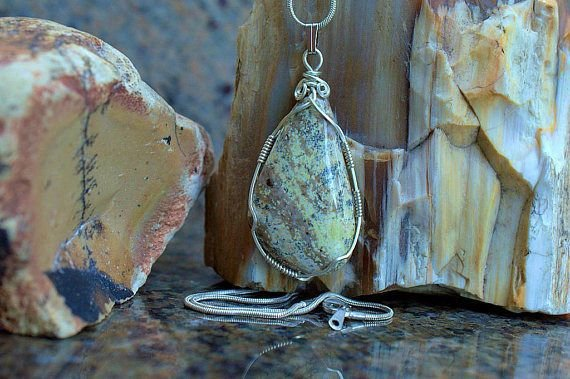 beige gemstone pendant lizardite necklace with silver wrapping
