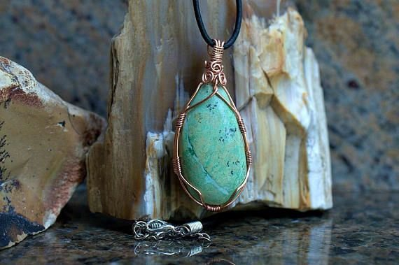 light green natural stone pendant with copper wire wrapping