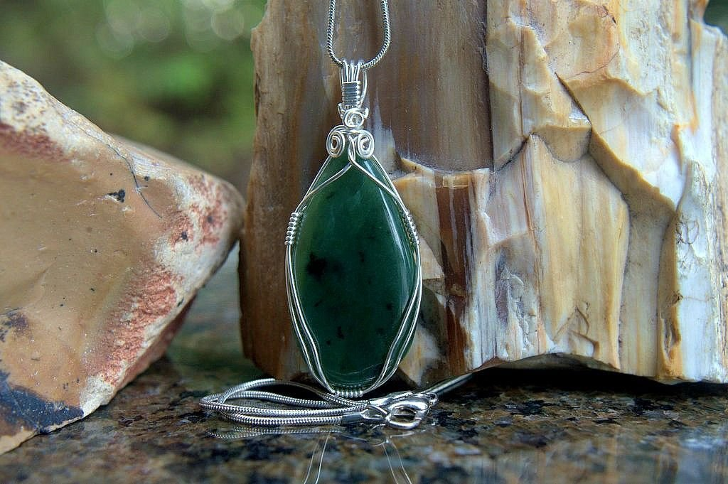 green semi translucent jade gemstone with silver wire wrapping