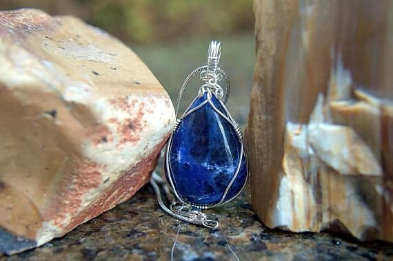 royal blue gemstone with silver wire wrapping