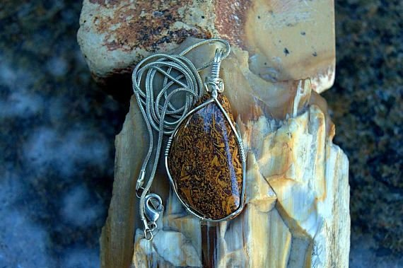 orange brown mineral with script writhing like patterm