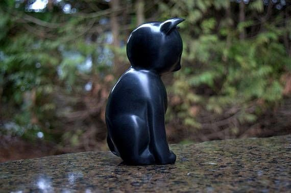 black shiny stone cat figurine in sitting position