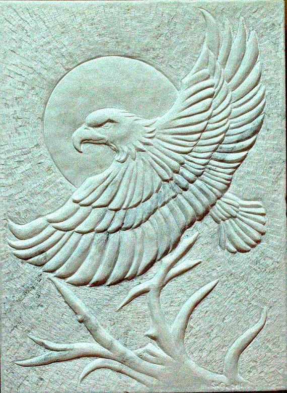 white hand chiseled marble wall panel with eagle flies with the sun in back ground