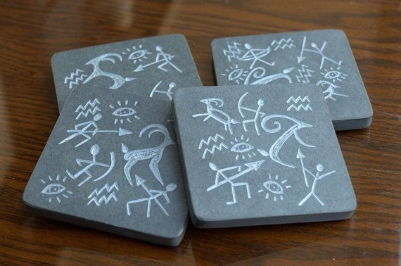 square shape black stone coaster set with hand carved hunting stick figurines