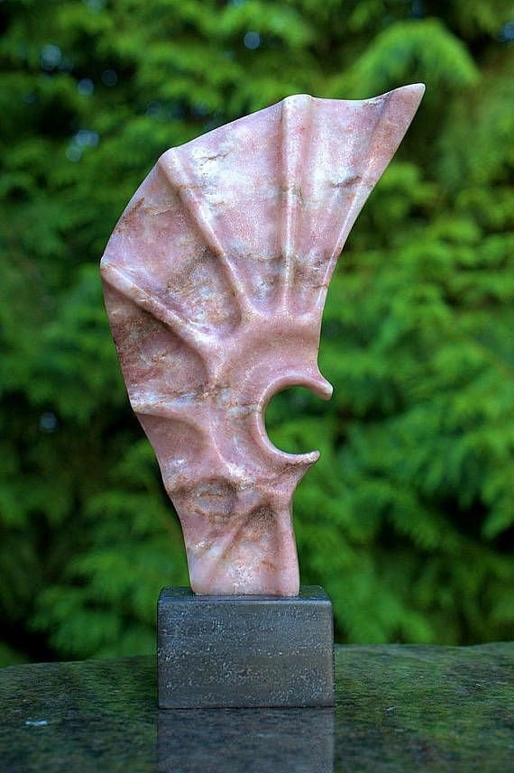 pink abstract stone sculpture narrow bottom widening top