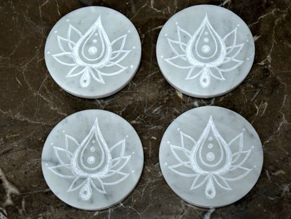Lotus flower carving on white disc shape marble stone