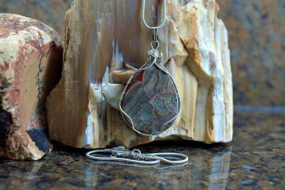 mushroom heads like pattern stone pendant hanging on raw stone