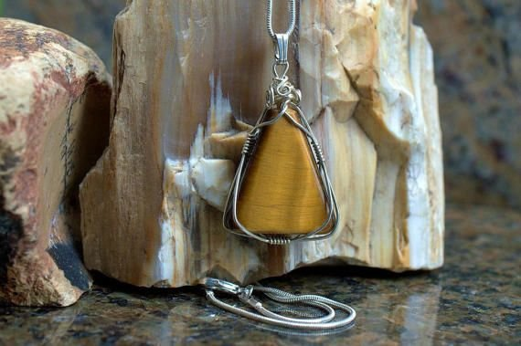 golden reflecting triangle shape gemstone with silver wrapping