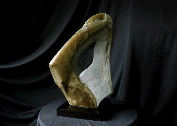 brown and gray color stone sculpture on black scuare shape base