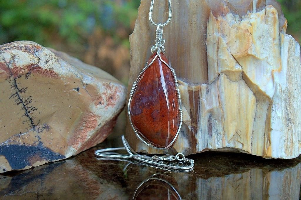 red gemstone pendant with silver wire wrapping