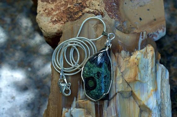 dark green gemstone pendant with black crocodile skin like pattern