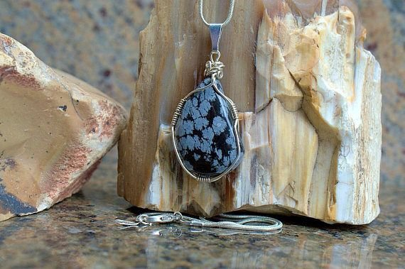 black gemstone with snow flake like white pattern