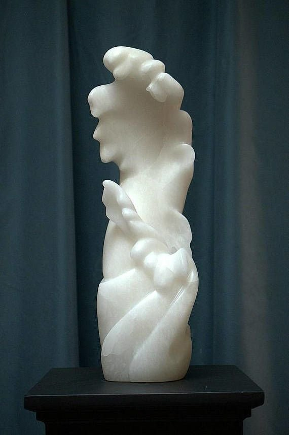 large white abstract sculpture on padestal