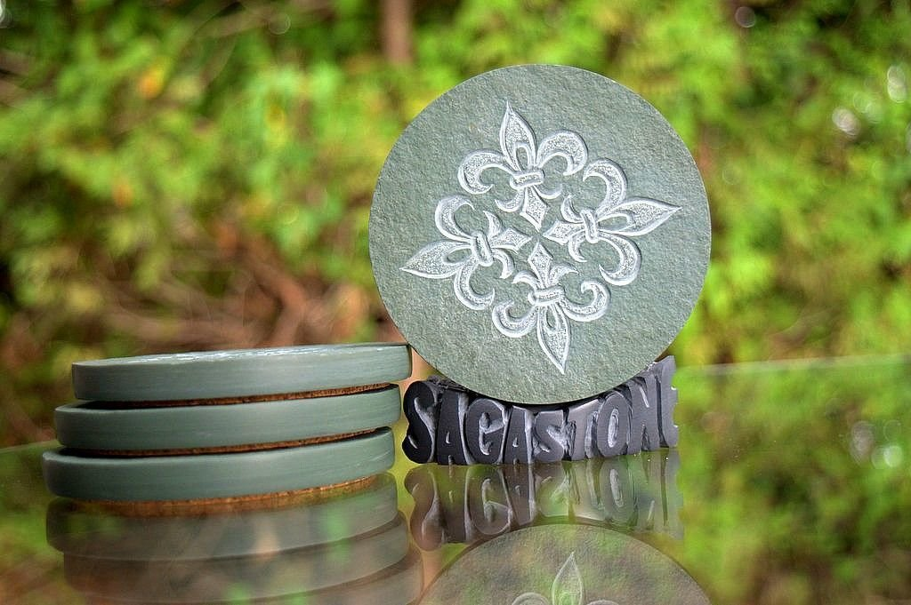 green carved round stone with lily design