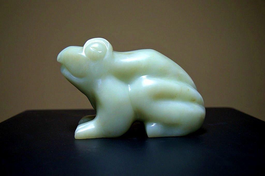 sitting frog light green stone sculpture