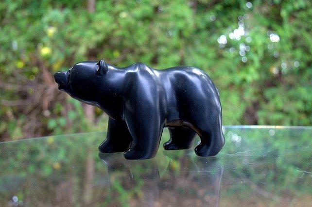 shiny black walking bear stone figurine