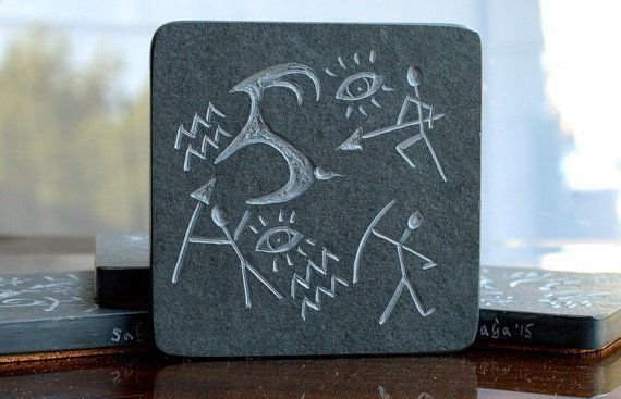 black square shape stone with primitive hunting carving