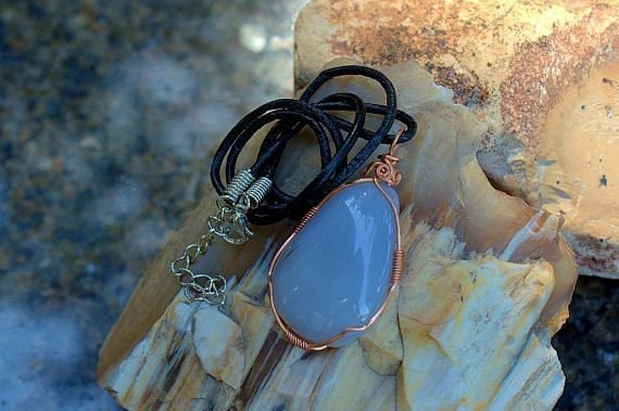 blue gemstone in copper wire wrapping pendant