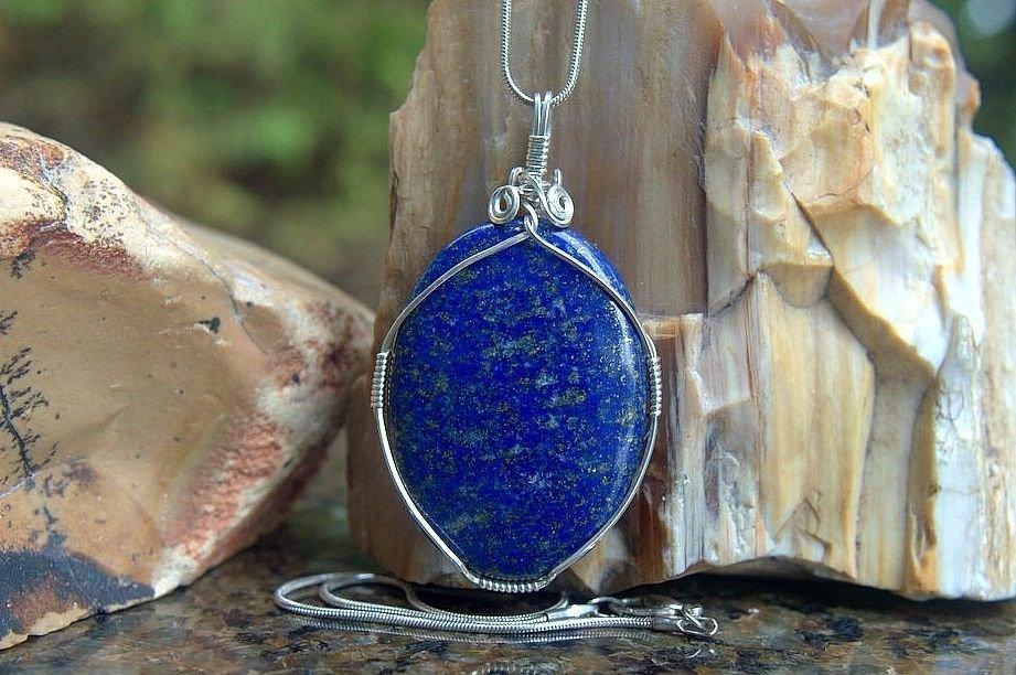 large blue oval shape gemstone pendant