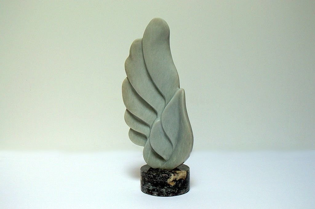 blue wing carving on black round stone base