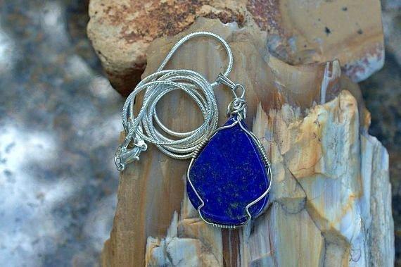 royal blue teardrop shape gemstone pendant in silver setting