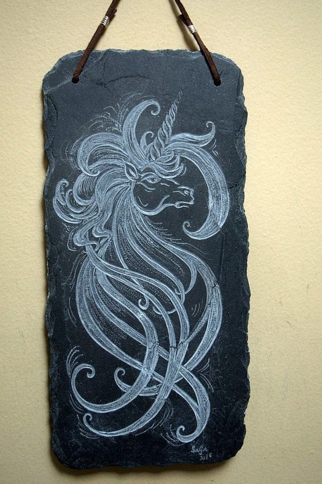 abstract unicorn carved black stone panel