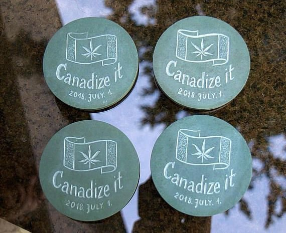 green stone coasters with Canada flag cannabis inside