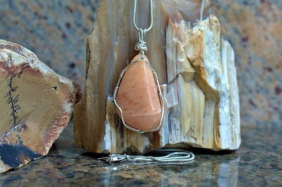 orange color large mineral pendant in silver setting