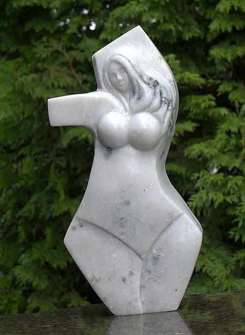 white marble woman torso art sculpture