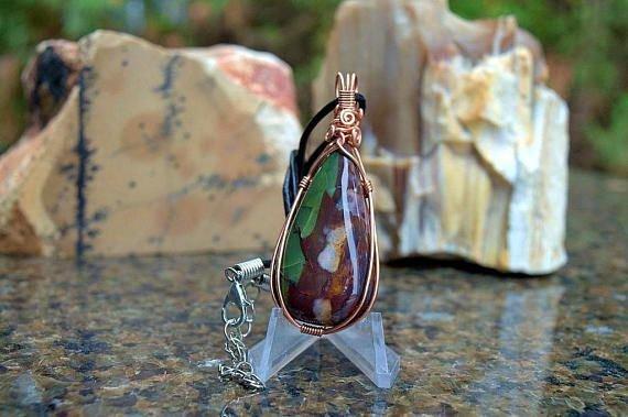 brown teardrop shape jasper stone with purple pattern