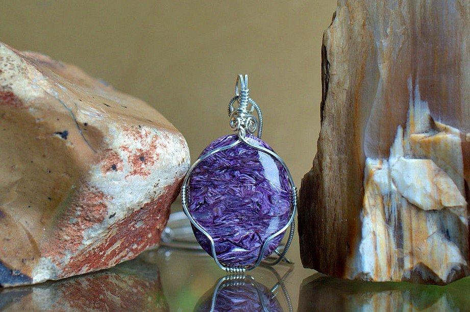 swirly pattern purple gemstone pendant with silver setting