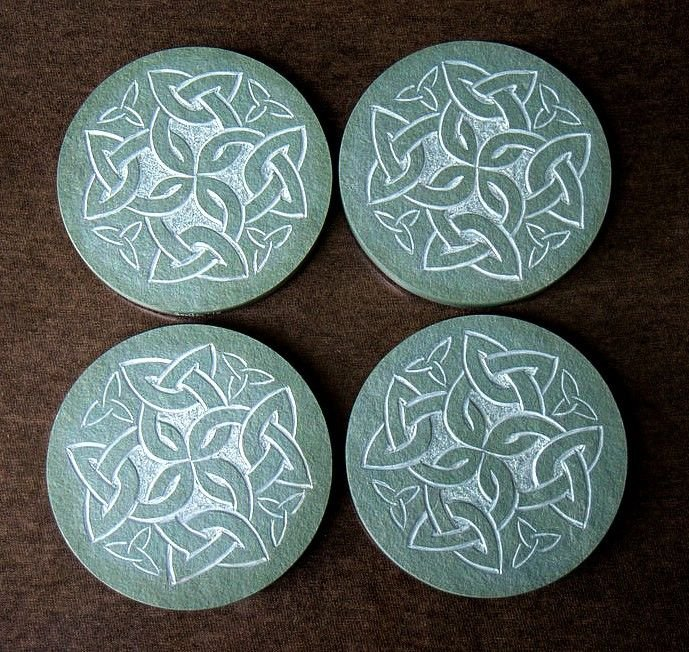 four pieces of round shape green stone with hand carving