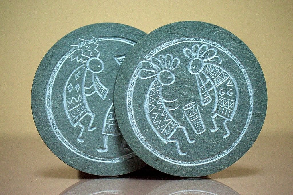 dancing fluting figure carving on green round stone