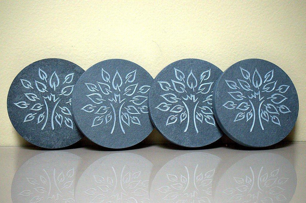 black stone round shape coasters with tree of life symbol