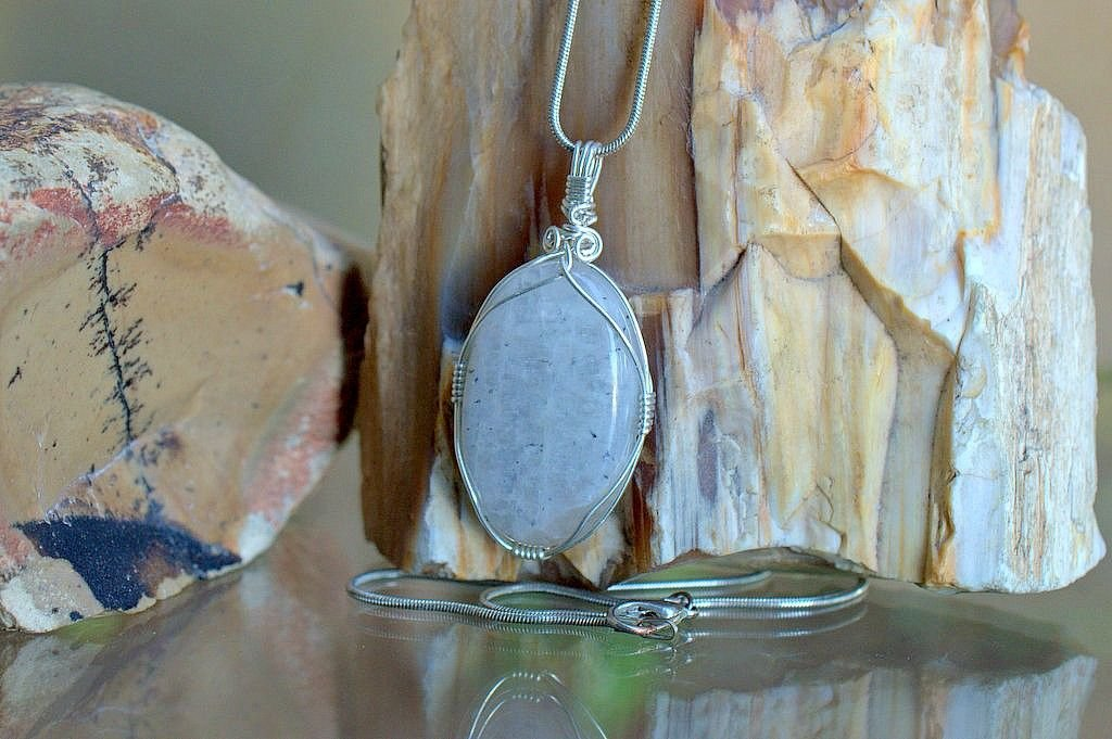 white gemstone with shimmering blue sheen pendant